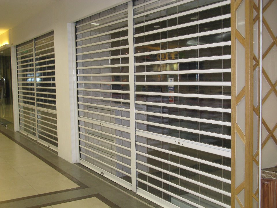 Vertical see through polycarbonate roller shutter singapore rolling shutter pte ltd - The rolling shutter home in bohemia ...